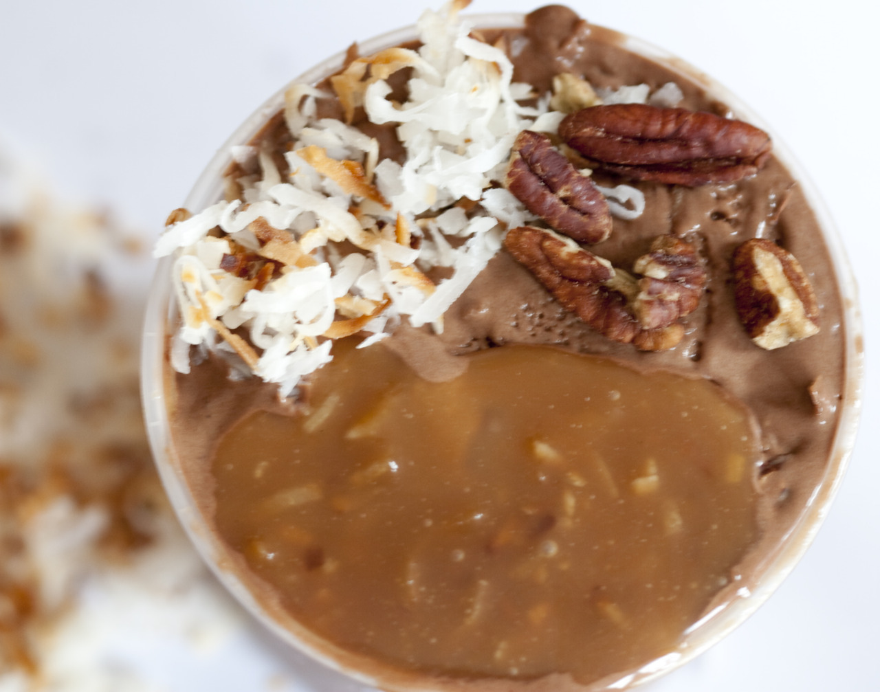 milkmade flavor of the month: German Chocolate Cakechocolate coconut ice cream with toasted pecans, layered with a rum-spiked toasted-coconut caramel sauceOur version of a traditional German Chocolate Cake. In ice cream form, of course. Made this one last summer to send to my father in sunny California in place of the actual German Chocolate Cake that we bake him every year for his birthday. Now we're finally releasing it for our members. Made with Mast Brothers Conacado chocolate. That's one intense pint!