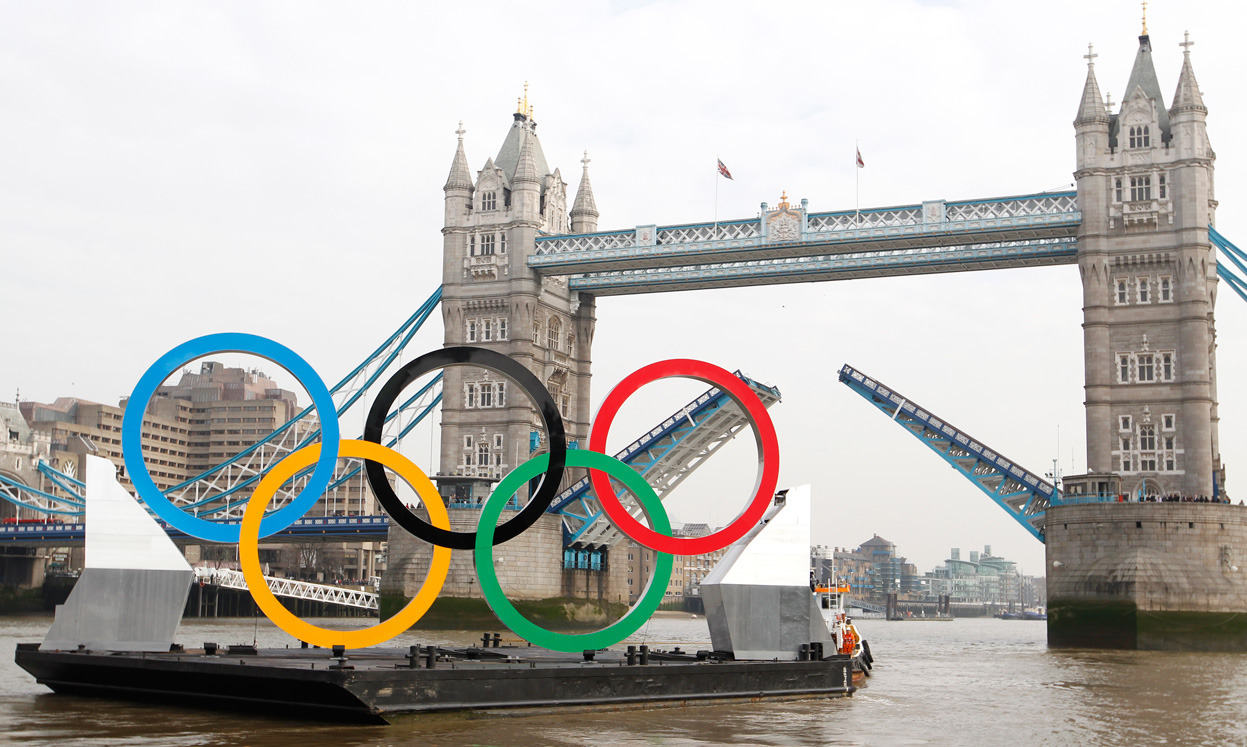 From Olympic Preparations for London 2012, one of 45 photos. Olympic rings mounted on a barge are maneuvered to pass under Tower Bridge during a promotional event for the London 2012 Olympic Games, on the River Thames in London, on February 28, 2012. (Reuters/Andrew Winning)