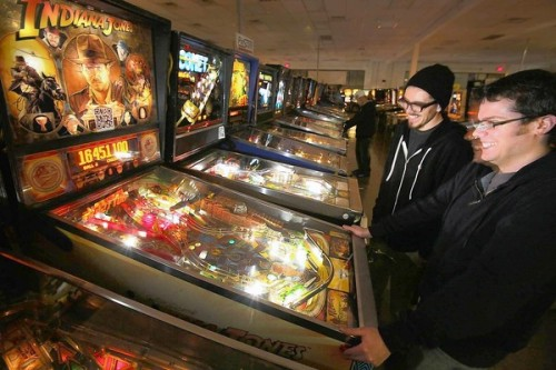 Pinball Hall of Fame in Las Vegas tilts toward nostalgia: The Pinball Hall of Fame in Las Vegas has its winners and its winners: the visitors who play the games love the chance to enjoy them again, and their quarters benefit charity. Photo: Two visitors enjoy one of the vintage machines at the Pinball Hall of Fame in Las Vegas. Credit: Brian van der Brug / Los Angeles Times