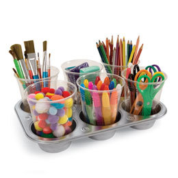 A jumbo-size muffin pan can serve as a handy tray for keeping markers, craft scissors, glue sticks, and the like at your child's fingertips.