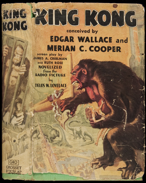 King Kong  Lovelace, Delos W. New York, Grosset & Dunlap, 1932.  Novelized from the Radio Picture by Lovelace. Conceived by Edgar Wallace and Merian C. Cooper. (8vo), original green cloth, lettered in dark maroon, pictorial endpapers showing several action stills from the movie, color pictorial jacket with wrap-around artwork. First Edition.   The original novelization for the 1933 King Kong movie classic as part of the film's advance marketing. Co-creator Merian Cooper was the key creative influence, saying that he got the initial idea after he had a dream that a giant gorilla was terrorizing New York City. Edgar Wallace, a famous writer of the time, died very early in the process and it is generally believed that little if anything of his ever appeared in the final story, but his name was retained for its saleability. Bleiler (1978), p. 127; Reginald 09268.