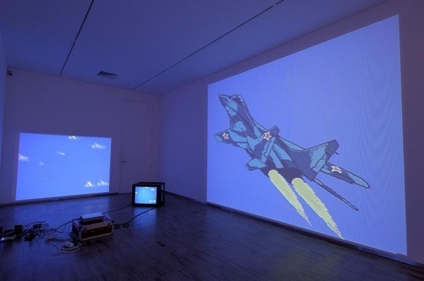 "The art: Cory Arcangel, MIG 29 Soviet Fighter Plane and Clouds, 2005. The news: ""Obama Tells GOP Critics War with Iran is 'Not a Game,'"" by Helene Cooper for the New York Times. The source: Collection of the Albright-Knox Art Gallery, Buffalo. Nota bene: Yes, I've used this Arcangel here before. But, you know, if POTUS goes there, we do too."