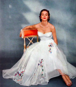 theniftyfifties:  Jean Patchett wearing a white embroidered evening gown for Vogue US, 1951.