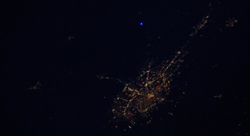 "theatlantic:  Amateur Astronomers from San Antonio Flash the Space Station With a Laser  The San Antonio Astronomical Association members decided it would be fun to calculate when the International Space Station was overhead, find a big laser, and shoot that laser at the ISS when an astronaut was watching. Why? Because no one had ever done it. Because they could. Because they love space. Because they'll always have that picture you see up there, which was snapped by astronaut Don Pettit, to prove that they touched space, at least with some photons. Read more.   oh my god tera lets do this with something other than a laser ""chuck a potato at the iss"""