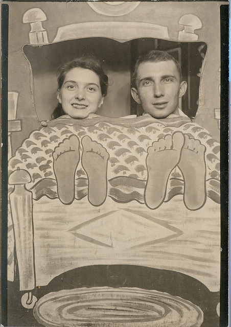 "Novelty arcade photo of couple with feet sticking out of ""bed"" by Kingkongphoto & celebrity photos on Flickr."