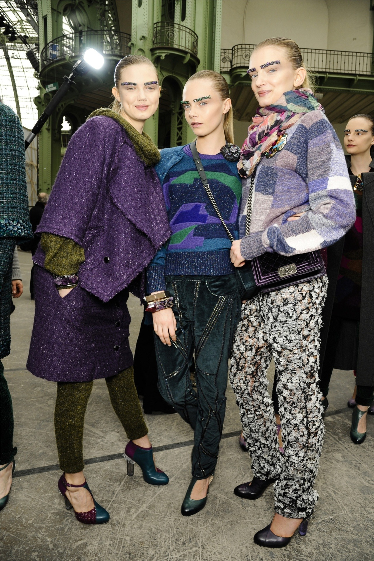 Lindsey, Cara and Lily backstage at Chanel fw12. cool girls.