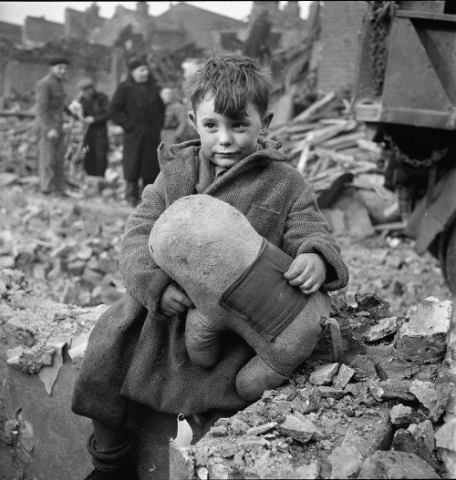 "lostsplendor:  ""Abandoned boy holding a stuffed toy animal amid ruins following German aerial bombing of London, England, United Kingdom, 1940"" (via World War II Database)"