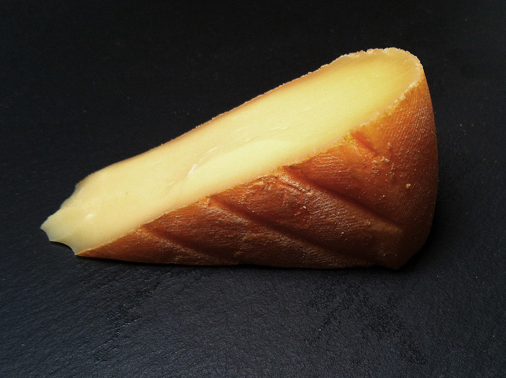 Chimay, a Belgian cow's milk washed rind cheese that is washed in the Trappist beer of the same name. Less pungent than some washed rinds and with a mild, meaty, nutty flavor with hints of hops. Pairs well with belgian beer (naturally). Purchased at Artisanal.