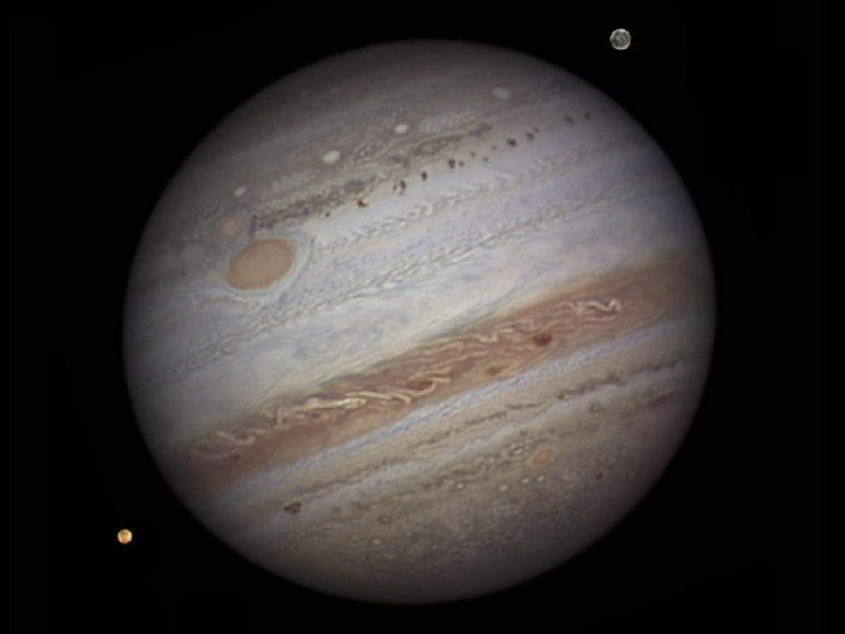 Stunning image of Jupiter and its moons Io and Ganymede captured by amateur astronomer. (via Image of Jupiter from a ground-based telescope)