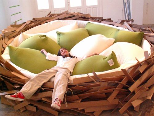 "Giant Birdsnest Bed by O*GE Designed by the team at O*GE, this massive bed replicates a bird nest in human size proportions. The concept behind the Giant Birdsnest Bed is ""creating new ideas.""  The designers had the following to say about the bed. ""It's powerful, yet simple concept and intriguing character needs no explanation or user manual: Ready to to be used, to be played in, and be worked in. With its 4.50 m diameter the big version can host up to 16 people at once, offering a comfortable and sensual soft space, various sitting positions, configurations for informal meetings and social exchange."""