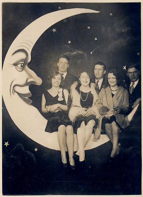Wonderful group photo of flappers and their beaux on a large paper moon c.1930s by ~BostonBill~ on Flickr.