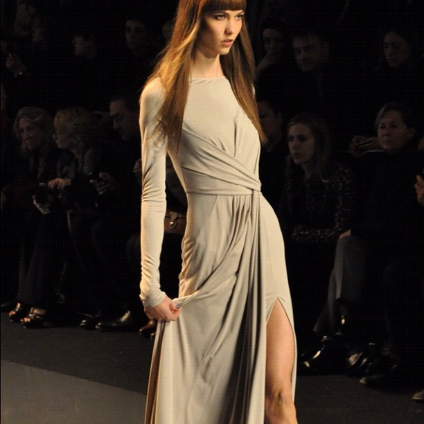 Karlie Kloss giving the photogs sexy face at showing some leg at Elie Saab #pfw  (Taken with instagram)
