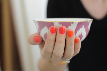 modcloth:  Bright nails and a bright teacup from Emily of Cupcakes and Cashmere.