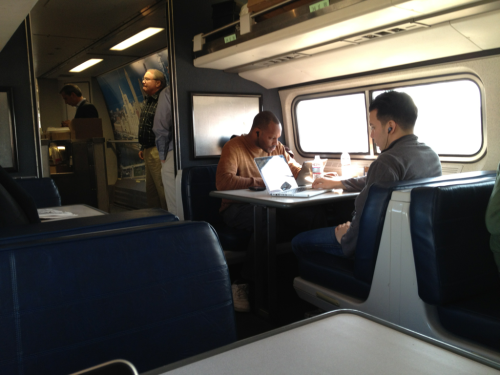 I love the Amtrak cafe car.  Nice tables, wifi, plugs, and a surprising amount of leg room.