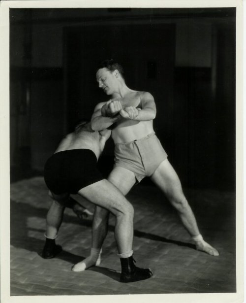 bksociety:  Vitage arm-bar/kimura.  Jimmy Cagney wrestling—handily—what looks like a much larger opponent.