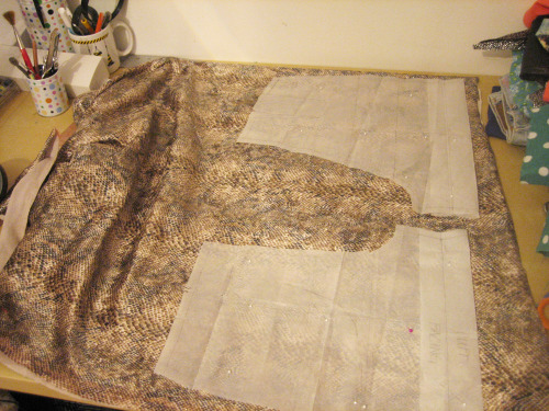 "snake print with slight sheen, this fabric has a ""nap"" so thats why I have to waste some fabric and face the fabric in one direction."