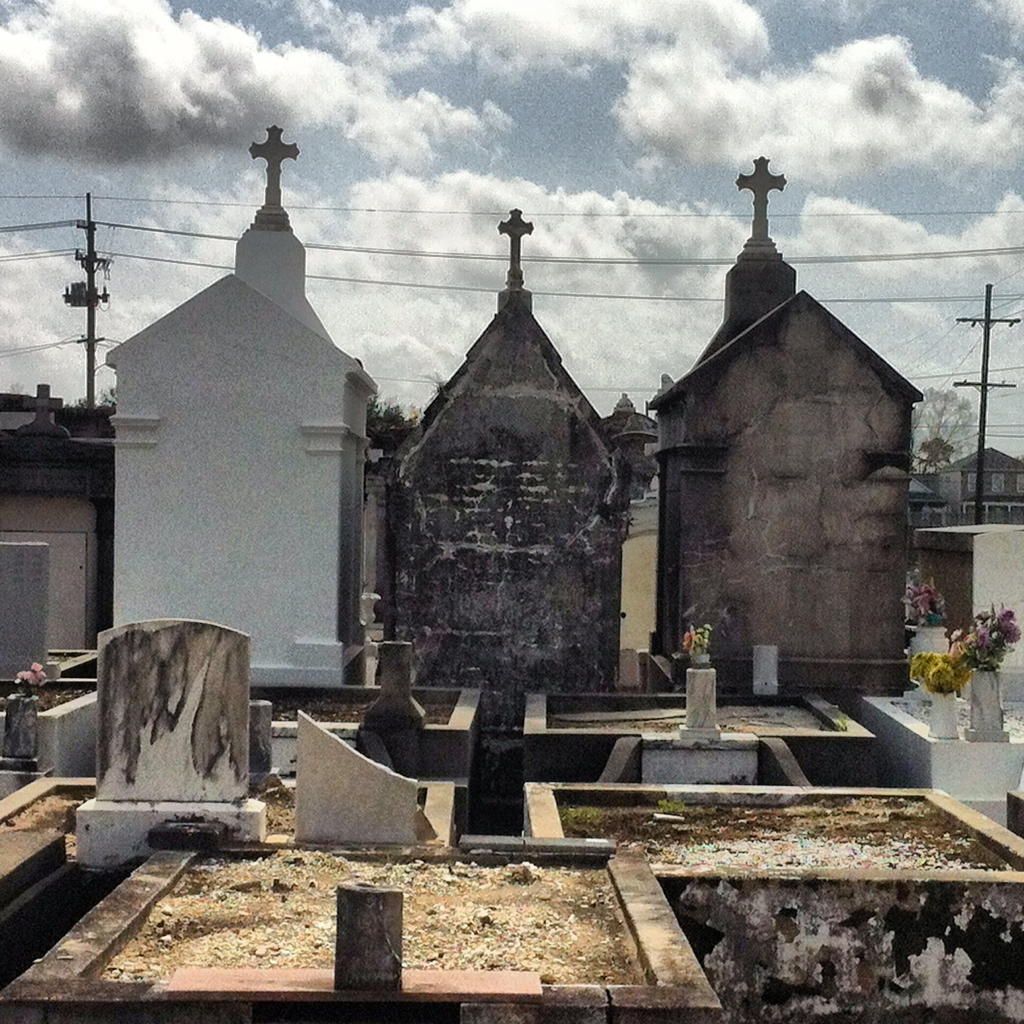 Another shot from the epic cross-country train trip. andrewonatrain:  Cemetery in New Orleans.