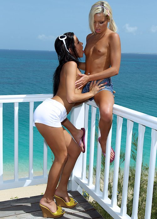 Kacey Jordan and Tanner Mayes topless in shorts overlooking the beautiful blue Caribbean ocean…