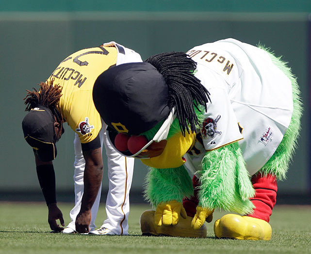 Pirates centerfielder Andrew McCutchen stretches with the team's mascot before a spring training game against the Yankees on Tuesday. McCutchen signed a six-year, $51.5 million deal earlier this week. (AP) LEMIRE: With McCutchen in fold long-term, Pirates ready to take next step