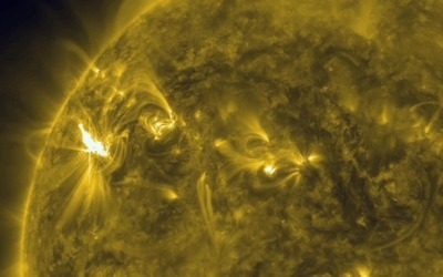 "theatlantic:  Beautiful, Mostly Harmless Solar Flare Headed Our Way  The solar flare pictured above erupted from the sun this week causing radiation storms that could affect Earth. Though solar flares are often described in somewhat apocalyptic language — the sun is ""exhaling its fury towards Earth"" writes The Washington Post Tuesday — this one will probably only briefly disrupt GPS users and power grids later this week. Meanwhile we're struck as always by the dazzling visual it produced. [Image: Associated Press/NASA]"