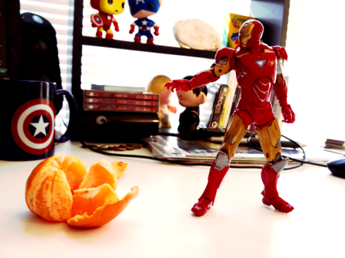 Why is Ironman taking out an orange?