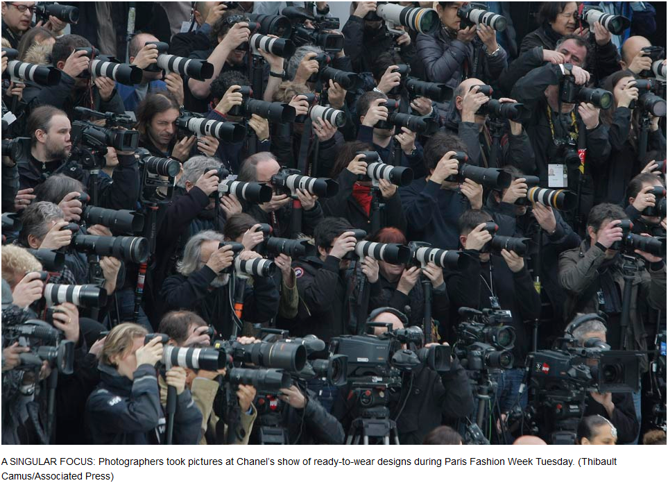 Bag's Take-Away:  All the hip photogs are wearing zoom. (See caption.)  via: Wall Street Journal photo blog  Visit BagNewsNotes: Today's Media Images Analyzed  —————  Topping LIFE.com's 2011 Best Photo Blogs — also follow us on Twitter and Facebook.