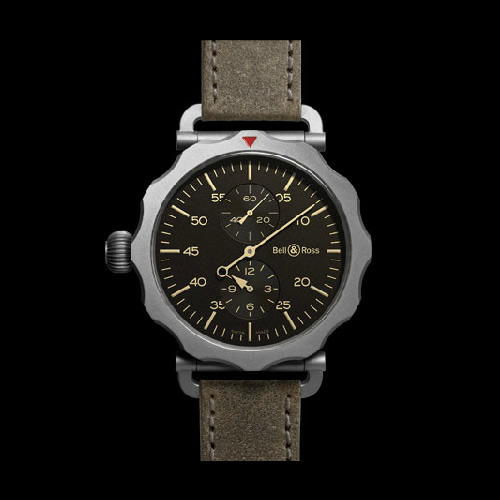 Bell & Ross WW2 Bomber Regulatéur Bell & Ross adds a new shape to the collection, the WW2 Bomber Regulatéur. Inspired by navigational tools from the 30s and 40s, the new timepiece features a Dubois Dépraz automatic movement, a sandblasted grey PVD 49mm case, bi-directional notched bezel, and a distressed calfskin strap completes the look. Link