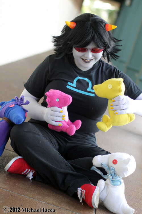 Myself (cancerously) cosplaying Terezi Pyrope from Homestuck. I'm not as large as some of the gorgeous ladies on here, but I certainly have my own issues with weight- I'm 150 lbs but I'm barely 5 feet tall, so it all relocates places I wish it wouldn't. On top of that, I've got a fairly large ribcage (37-38 inches) and almost no torso, so I end up looking pudgy no matter what I do. As you can see in this shot (part of the reason I chose it) I've got a pretty prominent stomach; I couldn't get a smooth line on my waist to save me. Back when I was new to cosplay, this tumblr actually helped me a lot in my inspiration to put my best foot forward and cosplay well. So thank you gals, so much, for showing me I don't need to be afraid even if I am terminally chubby. ♥