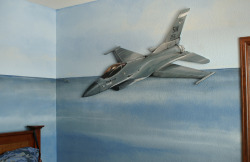 F-16 fighter jet mural in Castle Rock, Colorado home.  The jet is painted on masonite and cut out and mounted on the wall.  Solved the problems of painting a sleek plane on a textured wall and it will allow the family to take the jet with them if they move.