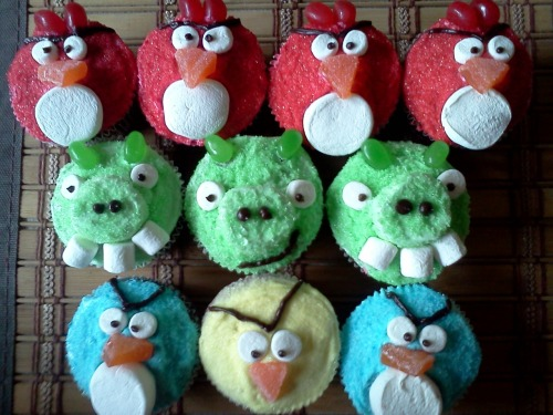 Angry Birds.  Lots of Marshmallows, dyed sugar & jelly beans.  Made them myself, red velvet from scratch.  -Cristhal