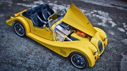 Morgan Plus E One selling point for electric cars is that they have massive heaps of torque available from a standstill. This largely negates the need for multiple gear ratios, but that hasn't stopped Morgan from trying out a five-speed manual transmission on their new Plus E electric car. The Plus E is Morgan's Plus 8 with a 94 horsepower, 221 lb-ft electric motor from the UK firm Zytek instead of a gas-swilling BMW V8. It's not that different from Morgan's Aero Supersports-based +E prototype. What's especially weird about Morgan's five-speed gearbox is that even though it uses a clutch like any other manual, you can keep the clutch engaged when stopped, and then pull away like driving an automatic. That's what peak torque at zero RPM can do. The unveiling at Geneva is really a sales pitch, as Morgan will only build the Plus E if there is sufficient demand. Photo Credit: Morgan