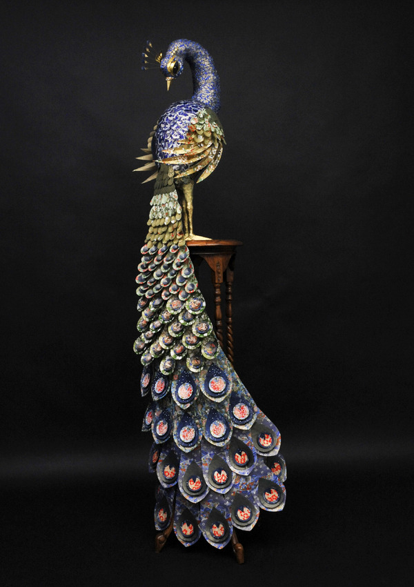 The Great Omar Peacock by The Makerie Studio. Life size reproduction of a peacock inspired by the cover of The Great Omar, a collection of Persian poems known as the most precious volume ever bound. The sculpture was produced for London paper merchants Shepherds Bookbinders using papers from their range, and is currently displayed in their Mayfair store. I cannot express in words how much I love this.
