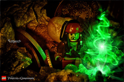 Lego - Pirates of The Caribbean       Strobist Info:Camera: Nikon D7000Exposure: 10sAperture: f/36Focal Length:35 mmISO Speed:200Flash: No flash, Just lighter on the left and Green LED on the right