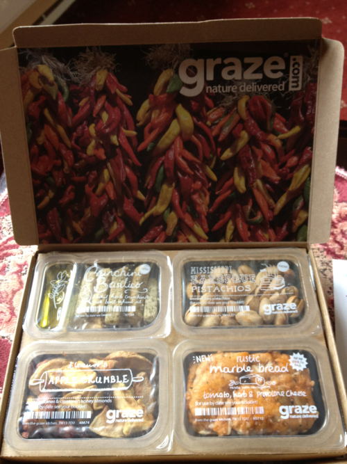 Yaaay new graze box! They have a new range of 'dips' too.  In this one I have Crunchini Basilico whih is little crunch bread things with a basil oil dip, only 80 calories!  Barbecue Pistachios (Yum! Anything BBQ flavoured is a plus for me) but they're 185 calories which is steep for a snack as I can only have 1200 cals a day.   Apple Crumble (115 cals) apple, sultanas and cinnamon honey almonds.  Rustic marble bread (109 cals) with seeds and whole grains, tomato, herb and provolone cheese. I'm so happy to have something cheesy in here!  Looking forward to trying all of these out :D