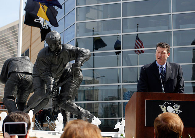 The Pittsburgh Penguins unveiled a 4,700-pound bronze statue honoring Mario Lemieux on Wednesday. The statue, which stands outside Consol Energy Center, depicts Lemieux splitting a pair of defensemen on his way to scoring a goal against the New York Islanders in 1988. (Gregory Shamus/Getty Images) GALLERY: Sports Figures With Their Own StatuesSI VAULT: Lemieux on his battle cancer (1.22.96)