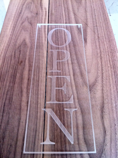 Laser engraved/cut acrylic OPEN sign for Sloane Boutique on Vine street.