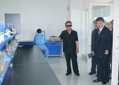 Kim Jong-Il looking at a countertop