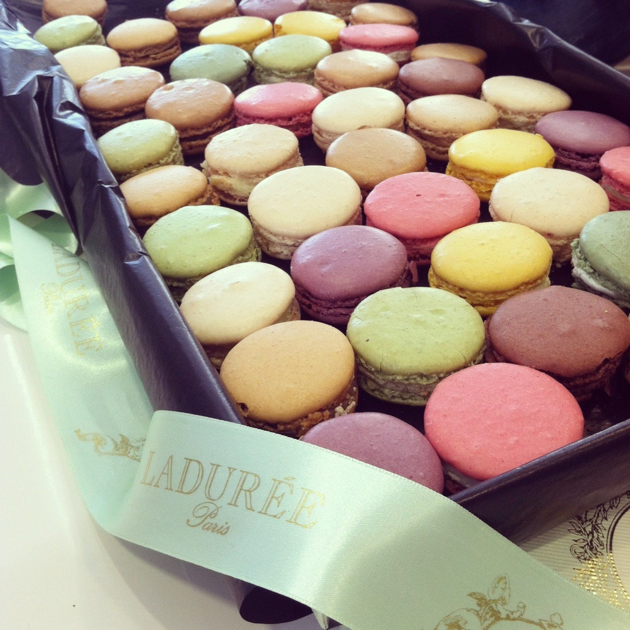 clubmonaco:   Ladurée Macaroons  It's always a treat to receive Ladurée macaroons in the office. The colors are delightful!
