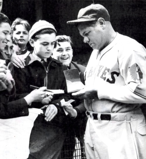 Babe Ruth signing autographs at the Polo Grounds before a game with the Giants. April 1935- one month before Ruth left the Boston Braves (now the Atlanta Braves) in a trade to the New York Yankees.