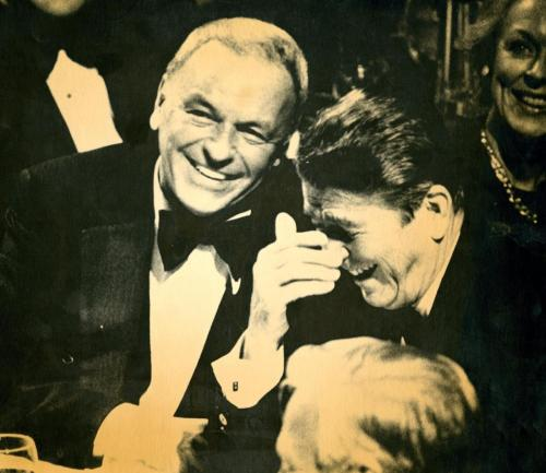 "Presidential candidate Ronald Reagan laughs while Frank Sinatra joins in with a smile at a ""prelude to victory"" dinner in New York. 10/1/1980"