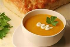 Spicy Pumpkin and Chile Soup 1/4 cup butter 1 large onion, chopped 2 cloves garlic, sliced 2 lbs pumpkin or butternut squash, peeled, seeded, and cubed 1 potato or sweet potato, diced 1 mild green chile, seeded and sliced 1 fresh red chile, seeded and sliced 2 teaspoons whole coriander seeds 1 tablespoon cumin seeds 1 teaspoon crushed red pepper flakes 1 teaspoon smoked paprika 5 cups vegetable broth Freshly squeezed juice of 1 lime Salt and freshly ground black pepper 2 tablespoons cilantro, chopped 2 tablespoons plain yogurt, optional Melt the butter in a large soup pot over medium-low heat. Add the onion and saute until softened, 3-4 minutes. Add the pumpkin, potato, and chiles. Cook until the pumpkin turns golden at the edges, 5-6 minutes. Toast the coriander and cumin in a small pan over low heat until fragrant, 1-2 minutes. Grind with a pestle and mortar. Stir the toasted spices, red pepper flakes, and paprika into the pumpkin mixture and simmer 1-2 minutes. Add the broth, cover, and simmer until the pumpkin is tender, about 20 minutes. Puree the soup in a food processor. Return to the pan and stir in the lime juice. Season with salt and pepper, and additional pepper flakes for extra spice, if desired. Reheat the soup gently and stir in most of the cilantro. Sprinkle with the remaining cilantro, add a swirl of yogurt and serve. Serves:6 Calories:128