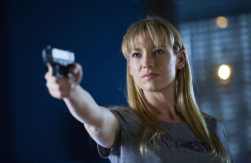 "For International Women's Day: a hot woman with a gun. Anna Torv plays FBI agent Olivia Dunham on ""Fringe"". I've been watching this lately (I do love my sci-fi) and I'm hooked: Torv is awesome, John Noble is brilliant as the mad scientist, and growing up looks very good on the dark-haired boy from Dawson's Creek. But what I wanted to say is that I love how Olivia is just a straight-up capable woman on this show. She's career-driven and great at her job without any fuss being made about it; no scenes of breakdown over her empty nest or any such qualifier to ""soften"" her. In fact, Olivia isn't presented as a strong woman so much as just strong, and it's refreshing. More, pls."