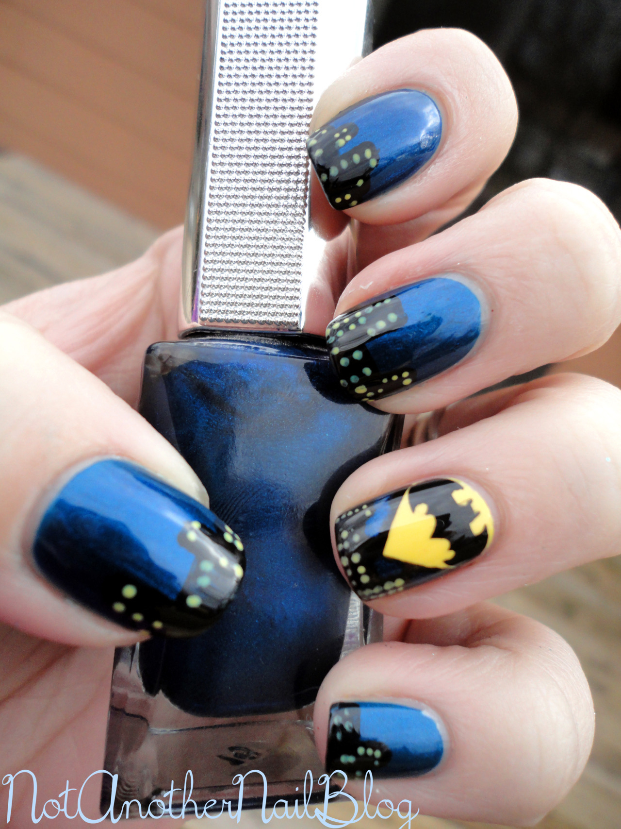 notanothernailblog:  Na na na na na na na na na na na na na na na na, Batman! Yes, yes. I'm sure you all already know how big of a geek I am so todays manicure should come as no surprise. I used China Glaze Liquid Leather, Zoya Pippa, and an unnamed blue (the bottle has no name or identifying markers).  What do you think?