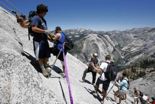 A big FYI to hiking fans: Yosemite Half Dome's new lottery permit system begins soon. The process, which gives would-be hikers until March 31 to apply for a reservation, is intended to eliminate scalping. Photo: Half Dome attracts flocks of climbers, who will be able to try to reserve a spot via lottery through the end of this month. Credit: Michael Maloney / San Francisco Chronicle
