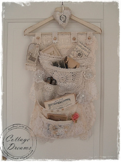 storagegeek:  Lace Pocket Hanger by xela66 on Flickr. Isn't this just the prettiest hanging pocket organizer you have ever seen? Make me want to tea dye all my lacy remnants.