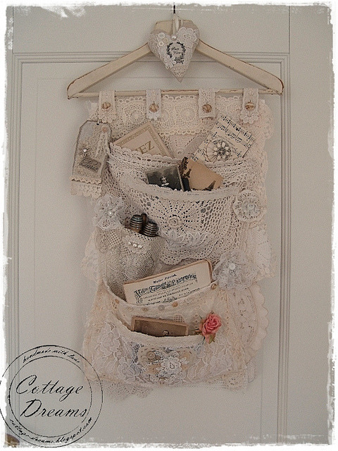 Lace Pocket Hanger by xela66 on Flickr.Isn't this just the prettiest hanging pocket organizer you have ever seen? Make me want to tea dye all my lacy remnants.