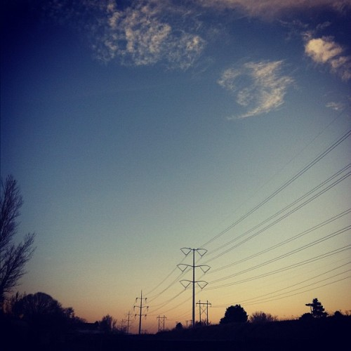 #sunlight #sky #sunset #trees #horizon #blue #orange #telephone #pole #fence #clouds (Taken with instagram)