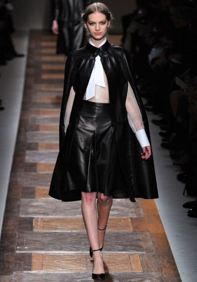 Valentino Fall RTW 2012 Model: Vanessa Axente  Opening look.   Even though no one usually think there would be the dominant use of black in a Valentino collection (now created/run by the duo Pier Paolo Piccioli and Maria Grazia Chiuri), it looks modern and feminine that it suits his name.