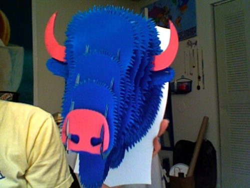I spray painted my cardboard bison head that my sister gave me. I just have to get some wood grain paper for the back tomorrow and then it's all done :D  *It's actually teal. Photobooth sucks