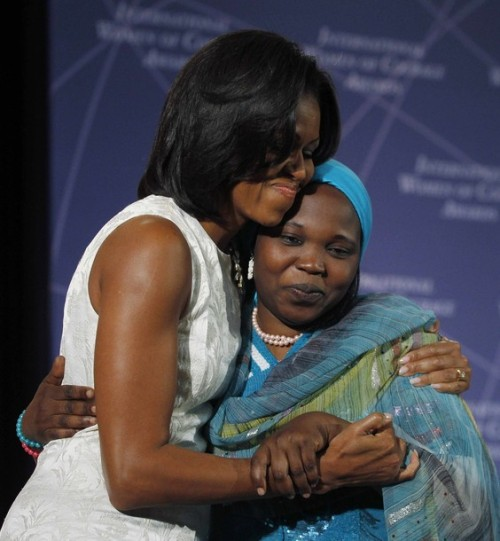 Hugs with the First Lady!  First Lady Michelle Obama hugs Hawa Abdallah Mohammed Salih of Sudan at the International Women of Courage of Awards 2012 at the State Department.